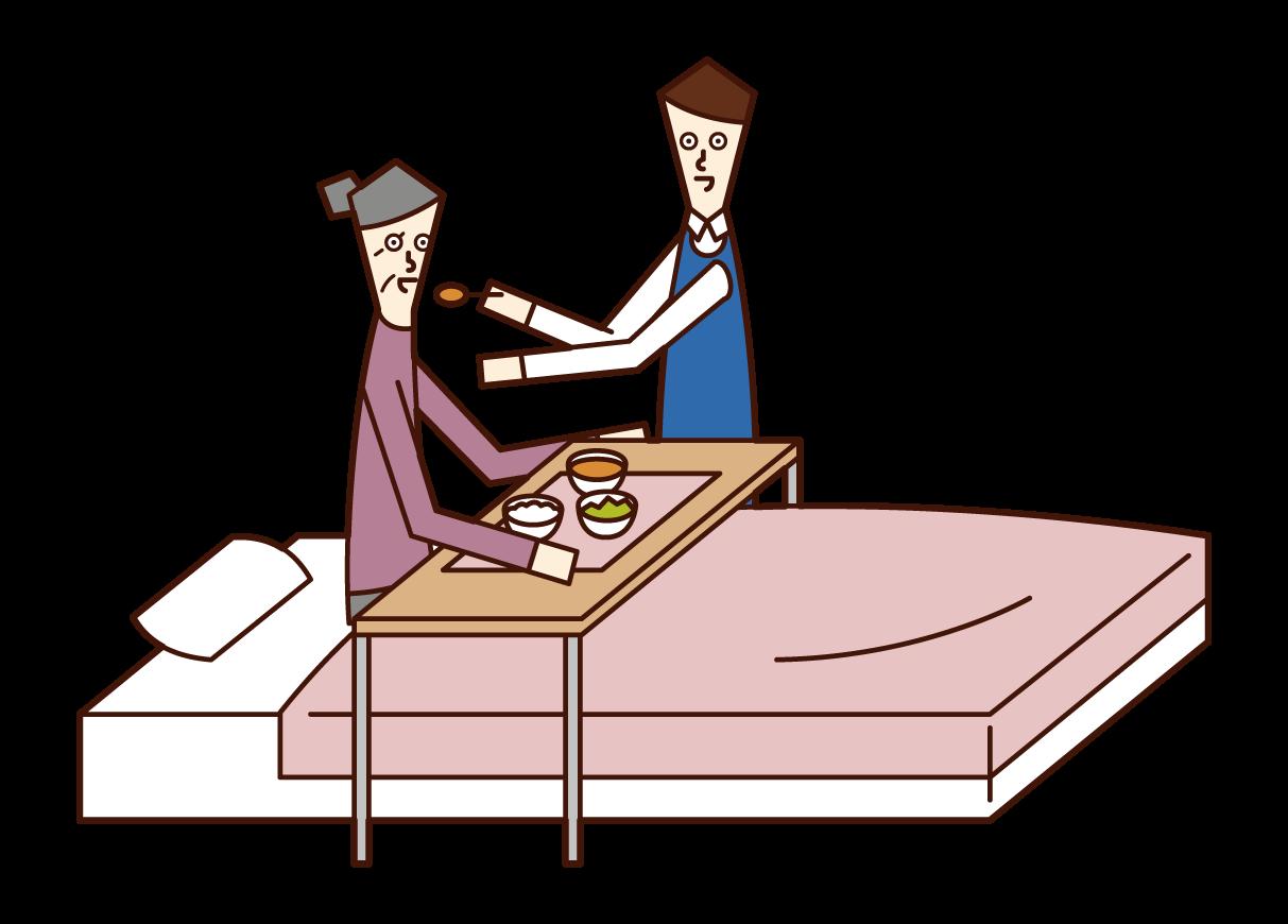 食事の介助をする介護福祉士(男性)のイラスト