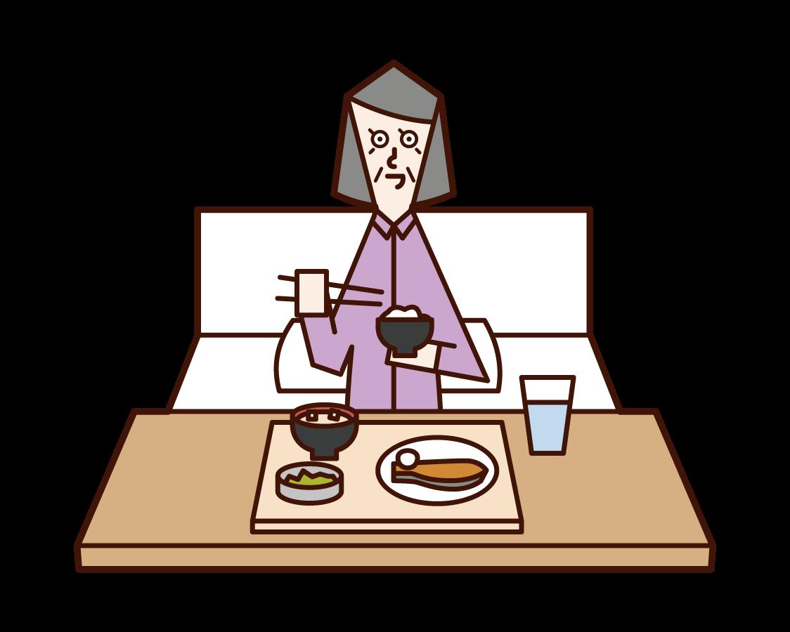 病院で食事をする老人(女性)のイラスト