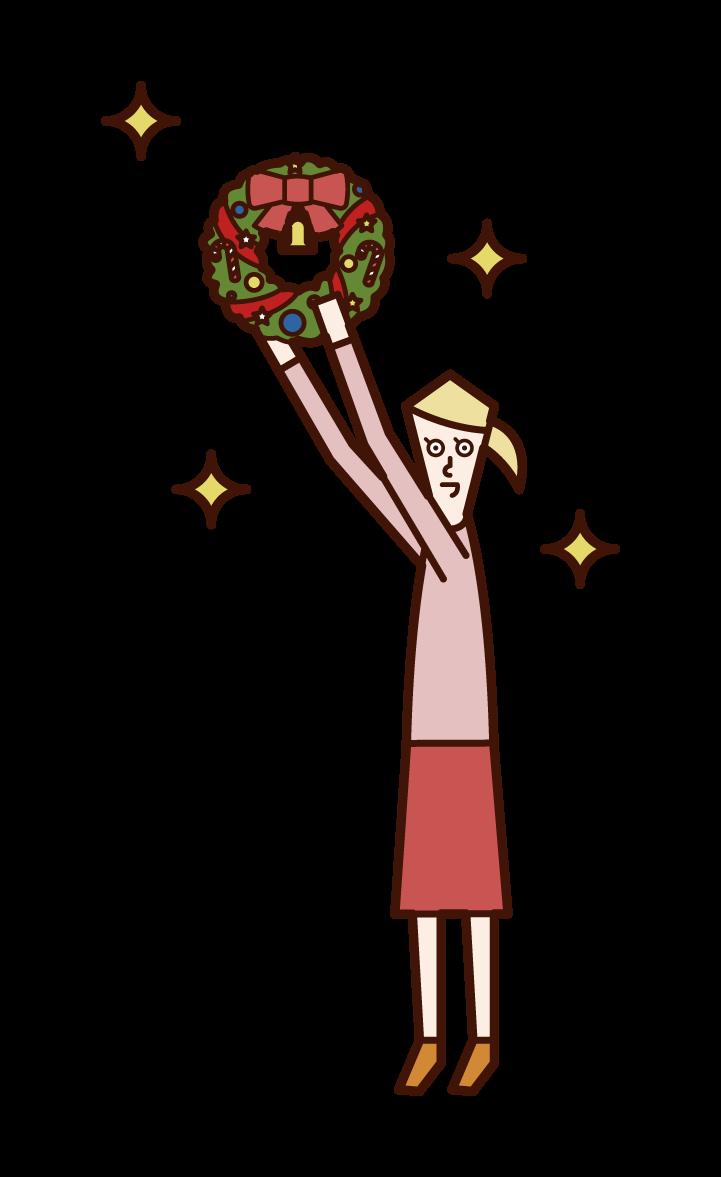 クリスマスリースを飾る子供(女子)のイラスト