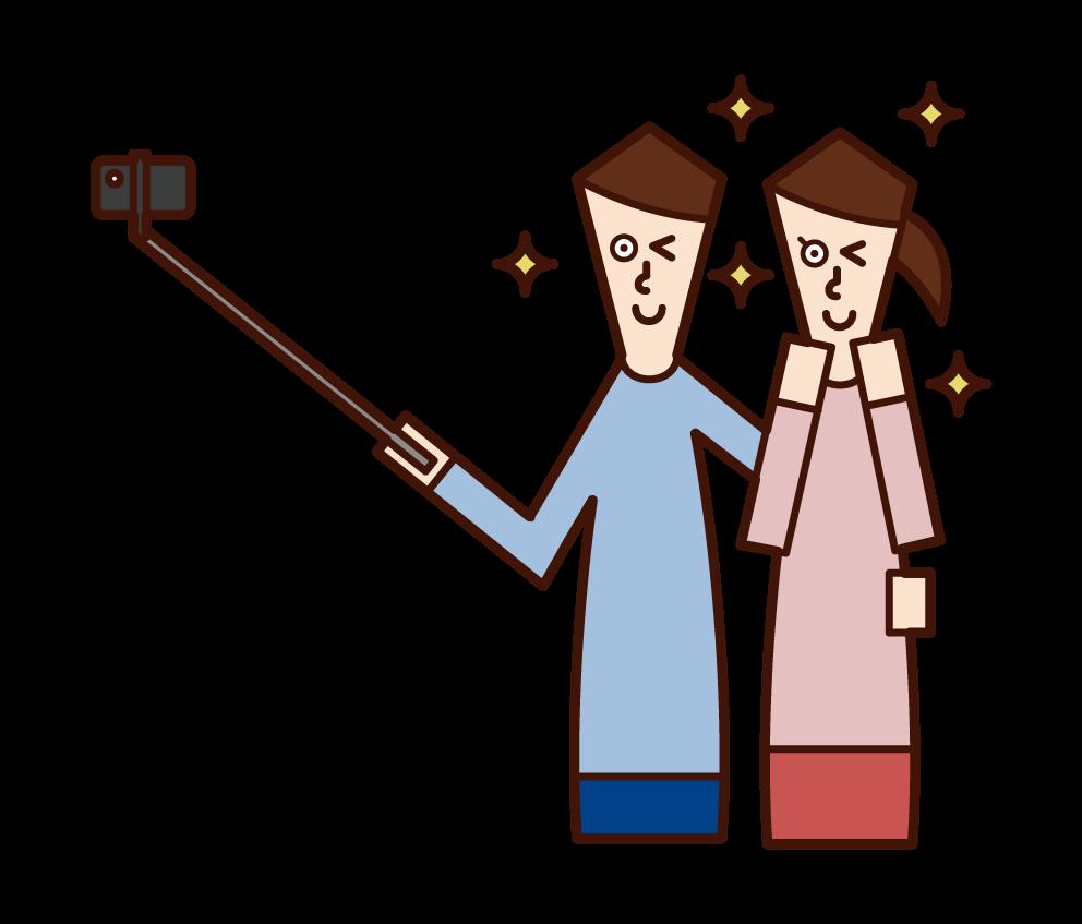自撮り棒を使って自撮りする人のイラスト