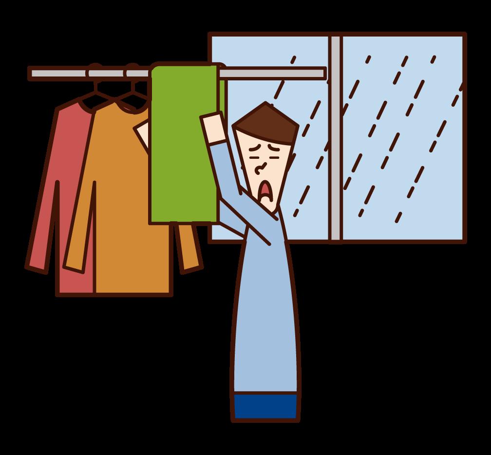 室內晾衣服的人(男性)的插圖