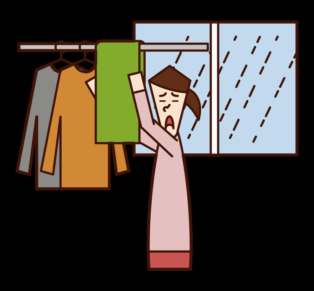 室內晾衣服的人(女性)的插圖