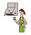 Illustration of a woman cleaning a ventilation fan and range hood