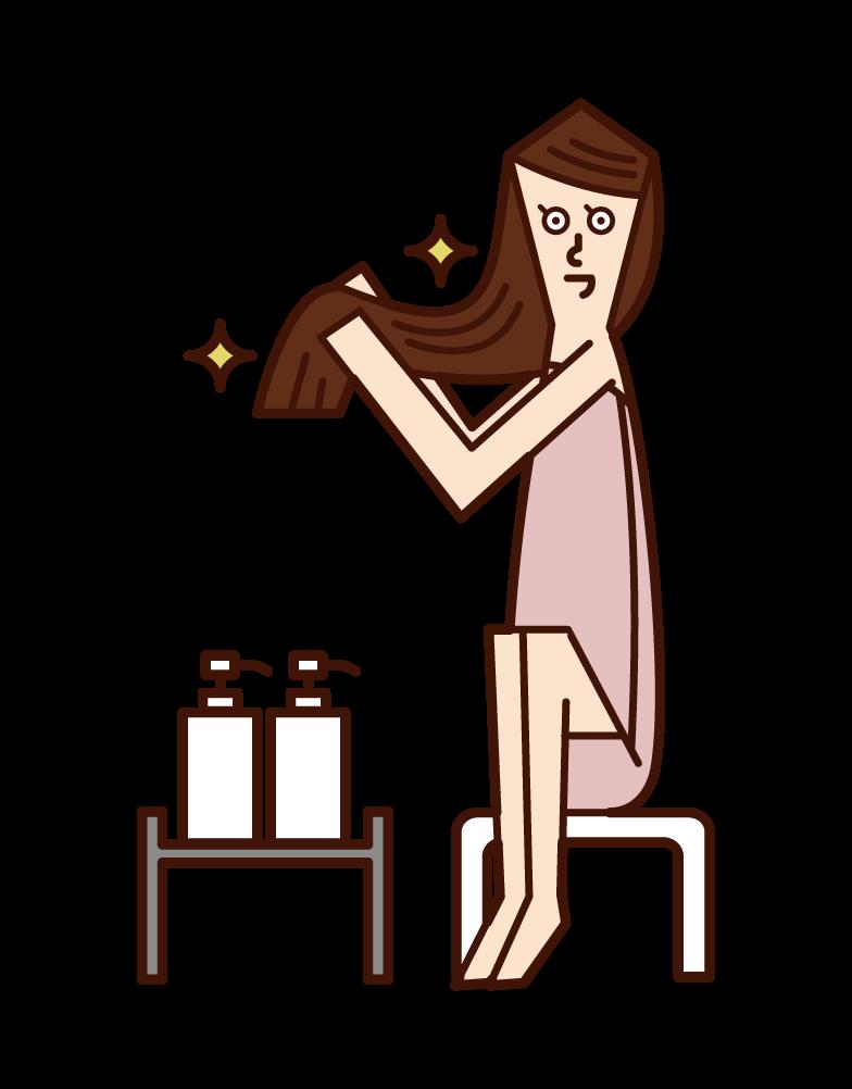 髪の毛にトリートメントをする人(女性)のイラスト