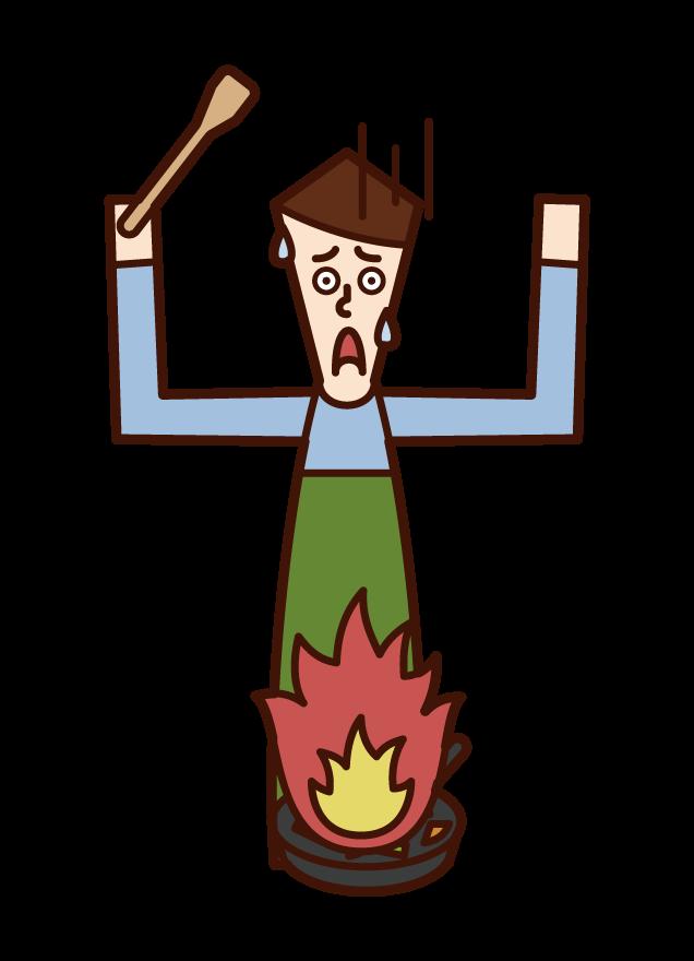 料理中の火災(男性)のイラスト