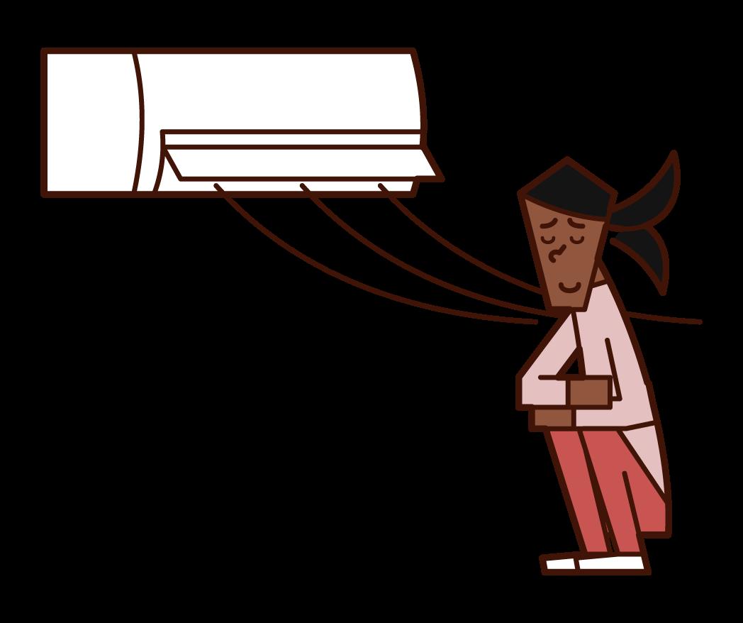 空調風中涼爽的人(女性)的插圖