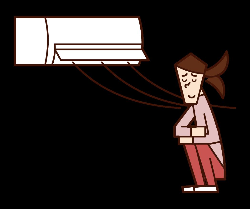 エアコンの風で涼む人(女性)のイラスト