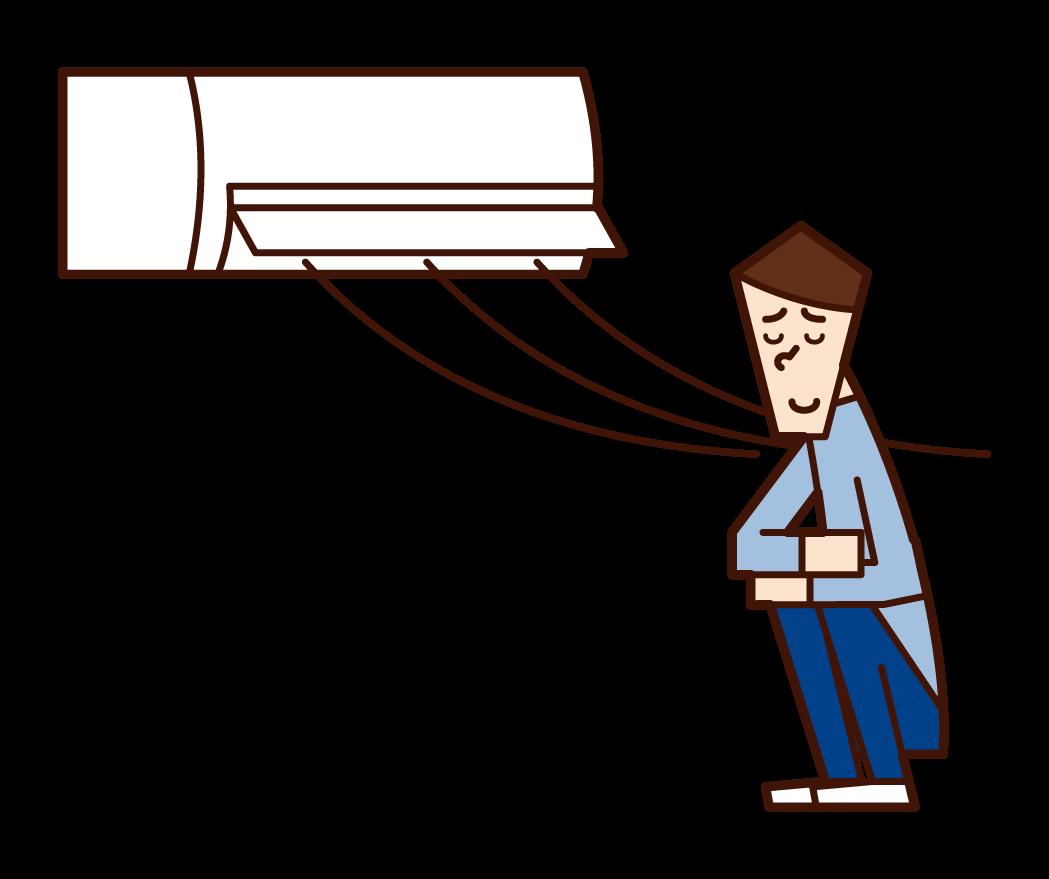 エアコンの風で涼む人(男性)のイラスト